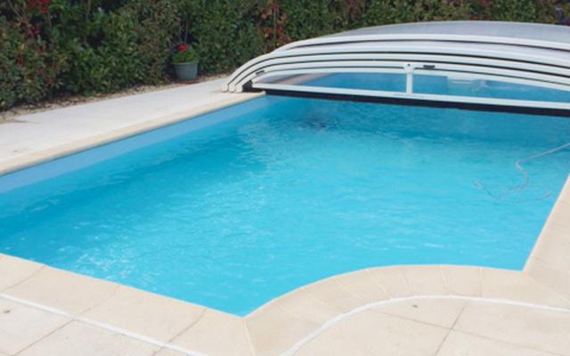 Abri bas télescopique sur rénovation piscine